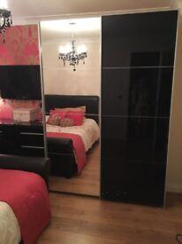 Black Gloss & mirror sliding wardrobe