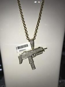 10k Yellow Gold With 0.80ct of Diamonds Gun Pendant
