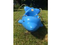 Swing seat shape of a dolphin