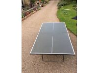 Fold up table tennis table