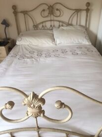 Double bed including mattress and bedding