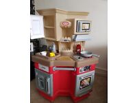 Little Tikes red kitchen, includes bag of plastic foods,knifes and forkes etc....
