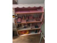 Girls doll house with furniture.