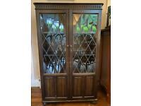 Oak display cabinet with lead glass doors