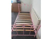 pink metal single bed frame no mattress some slats missing