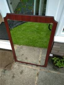 Large wall mirror with wooden back in cherry