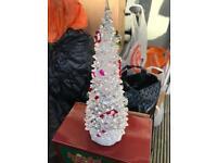 Illuminating glass Christmas tree