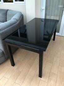 Noir black glass extending dining table
