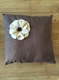 Cushion with flower display