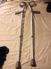 Crutches New cond adjustable upper arm and lower leg lenght