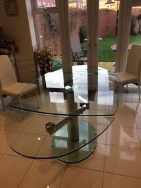 Beautiful oval glass extending table with 6 white faux leather chairs