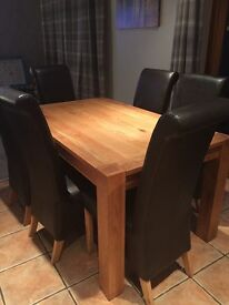 Solid Oak dining table (150 cms x 90 cms) and 6 chairs