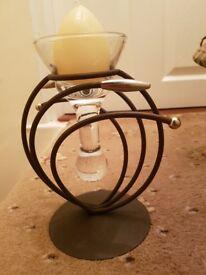 Metal sculptured candle holder