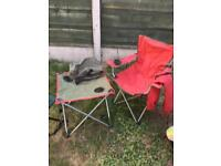 camping chair and table with stool.