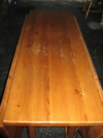 Drop leaf pine dining table.