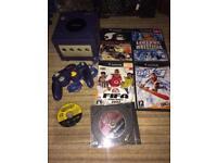 Purple Nintendo GameCube and games