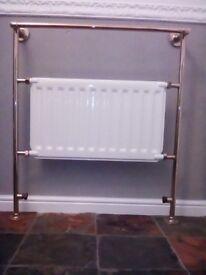 Brass heated towel rail and radiator