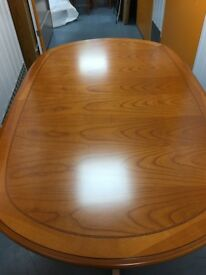 Solid wood 6 to 10 seater extending dining table and chairs.