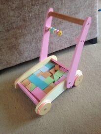 Pink walker with shape blocks