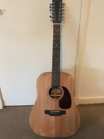 Sigma Electro Axustic 12 string guitar.