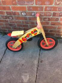 Child's wooden balance bike