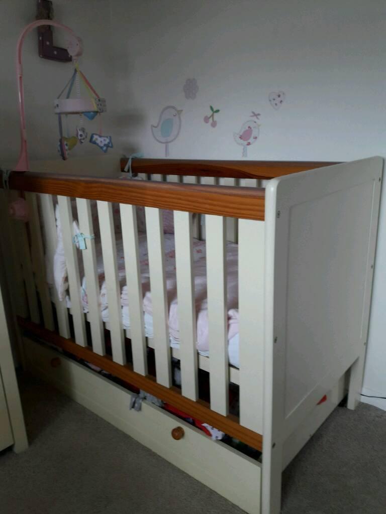 Cream wooden cot