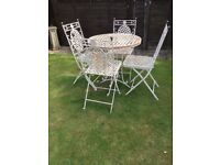 garden table and 4 folding chairs