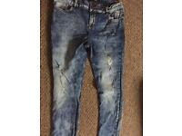 Women's ripped jeans size 14