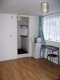 Studio flat in central location, all bills included, private patio and own front door
