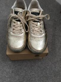 Gold Woden trainers. 37/4