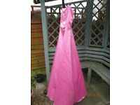 "Prom/bridesmaid Dress size 10 in Pink. Full length, net underskirt and spaghetti straps. Length 49""."