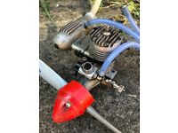 Os Max 20 Nitro engine with a box of glow plugs and a Rc plane engine starter and fuel tank