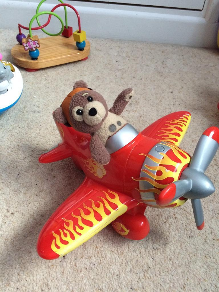 Charlie bear and plane toy