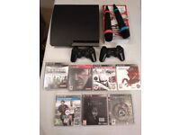 PS3 slim 160 gb. Perfect condition. Microphones and controllers
