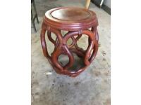Circular hardwood Indian side table