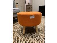 Orange footstool / pouffe
