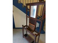 dark brown wood hall stand with mirror in the top