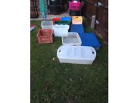 collection of plastic storage boxes