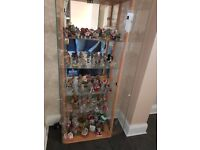 Pine cabinet full of me to u bear ornements and a few teddys