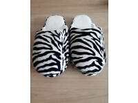 Zebra Print Fluffy Slippers. Size 5/6 / Medium. Only worn once. Good condition.
