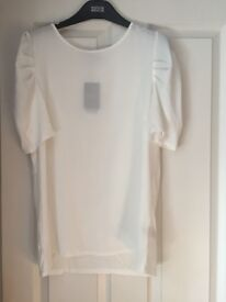 White Next top, size 12, unworn with tags. Crepe front and T-shirt material back. Puffy sleeves