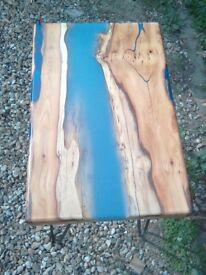 Handmade yew river table, with metallic blue resin on hairpin legs