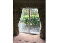 Curtains with tie backs.Patio doors and two window.