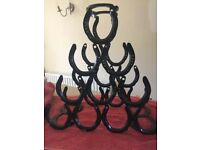 Handmade horseshoe wine rack, brand new, painted black, holds 10 bottles, perfect wedding gift