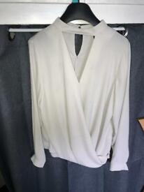 Light grey blouse, only worn a few times. Size 14