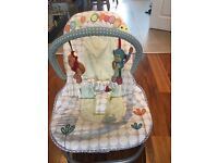 Mamas and papas baby rocker / bouncer chair with vibration and music
