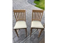 A pair of kitchen chairs