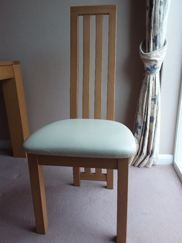 Set of 4 light oak high back dining chairs with leather seat pads