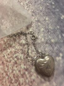 Silver old fashioned heart locket