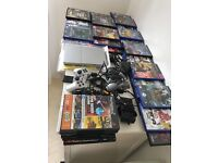 Mint condition slimline ps2 with huge games bundle two controllers one dual shock 8gb memory card